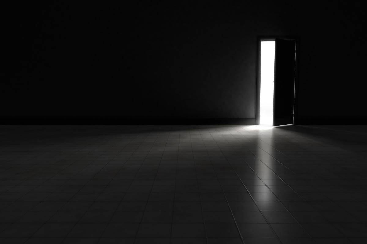 Open Door To Dark Room With Bright Light Shining In ...